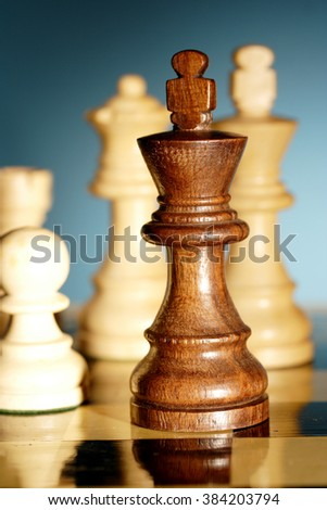 Closeup of chess king on chess board - stock photo