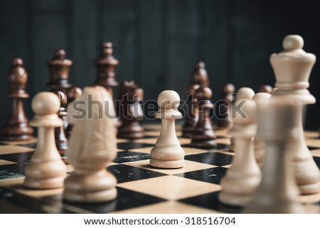 closeup of chess pieces on chessboard - stock photo