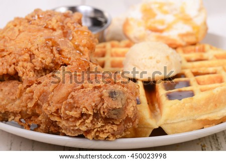 Closeup of Chicken and Waffles with honey, maple butter and maple syrup - stock photo