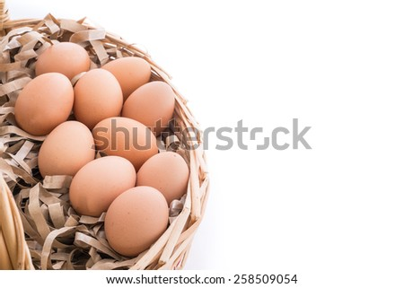 Closeup of Chicken eggs in the bamboo basket and  isolated on white background - stock photo