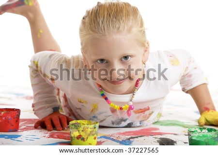 Closeup of child smiling child doing a painting session - stock photo