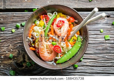 Closeup of chinese noodles, vegetables and prawns - stock photo
