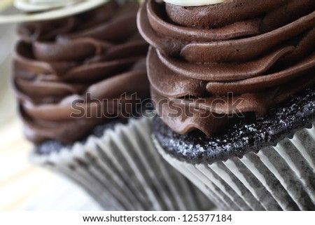 closeup of chocolate cupcake with chocolate mousse cream icing - stock photo