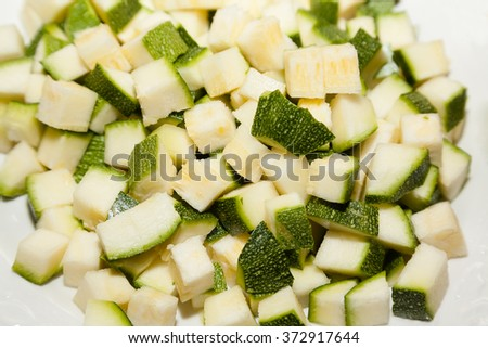 Closeup of chopped zucchini with selective focus - stock photo