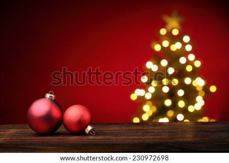 Closeup of Christmas ball on festive background - stock photo