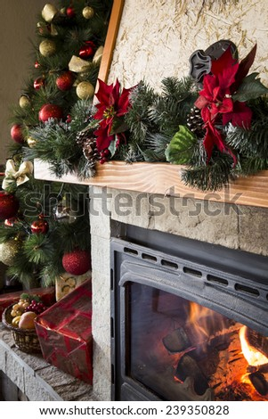 Closeup of christmas decorated fireplace - stock photo