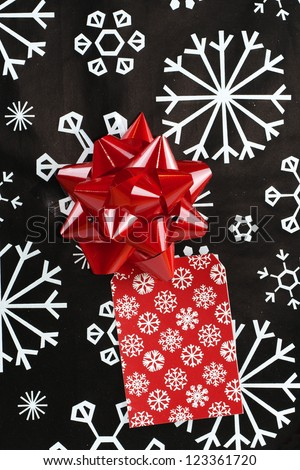 Closeup of Christmas Present with bow and gift tag - stock photo