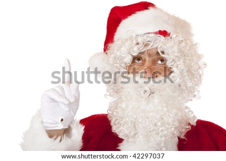 Closeup of Christmas Santa Claus pointing up with finger. Isolated on white.