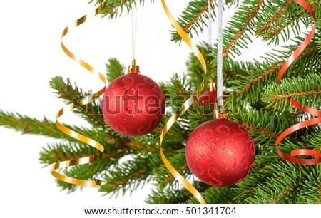 closeup of christmas tree with red balls