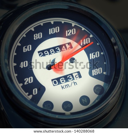 Closeup of chromed motorcycle speedometer - stock photo