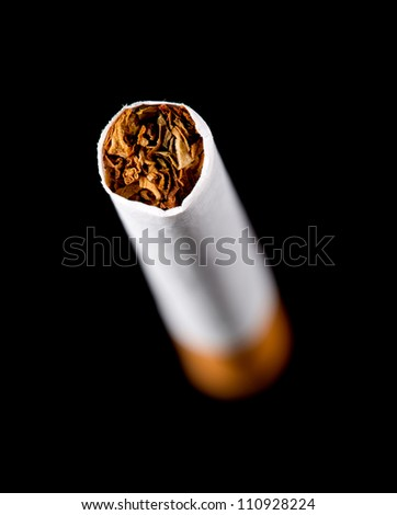 Closeup of cigarette tip. Isolated on black - stock photo