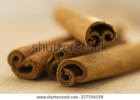 Closeup of cinnamon sticks on top of each other.