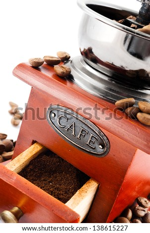 Closeup of classic coffee grinder on white.
