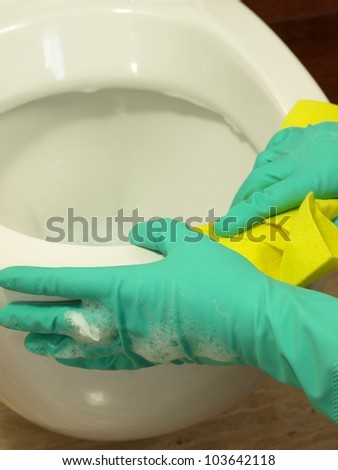 Closeup of cleaning a toilet with foam - stock photo