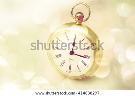 Closeup of clock with bokeh light effects added for effect