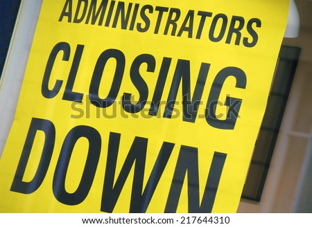 Closeup of closing down sign in shop window - stock photo