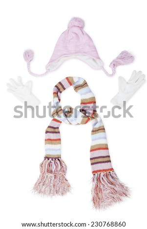 Closeup of clothing accessories for winter consist of a knitted scarf, hat, and gloves - stock photo