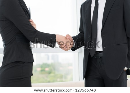 Closeup of co-workers' handshaking
