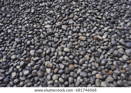 Closeup of cobble stones on Cobble Beach in Newport, Oregon.  The dark stones formed from lava being eroded over millions of years by the sea.