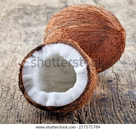 closeup of coconut on old wooden table - stock photo