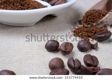 Closeup of coffee beans and roasted coffee heap. Arabic roasting coffee - ingredient of hot beverage. - stock photo