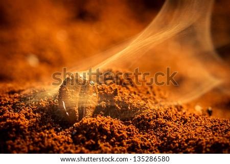 Closeup of coffee seeds roasting - stock photo