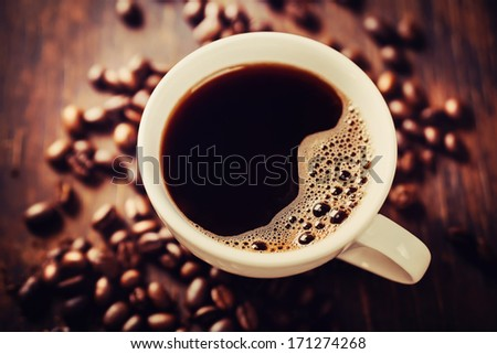 Closeup of coffee with crema. View from above. - stock photo