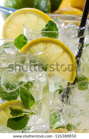 Closeup of cold lemon drink with mint - stock photo
