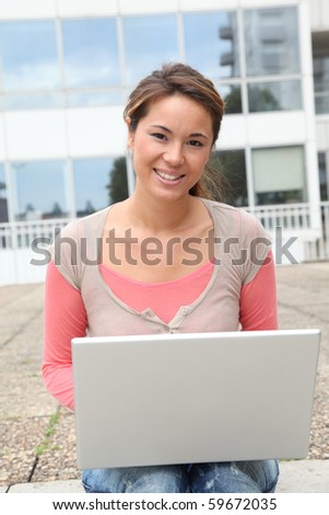 Closeup of college student with laptop computer