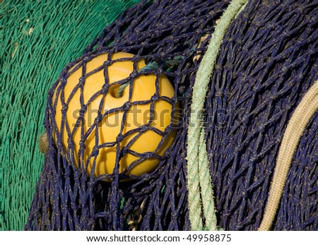 Closeup of color-full finshing net on a trawler. - stock photo
