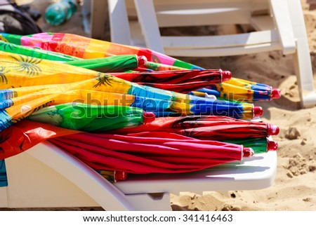Closeup of colorful beach umbrellas. Summer vacation relax coccept.