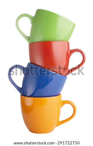 Closeup of colorful cups isolated on white background - stock photo