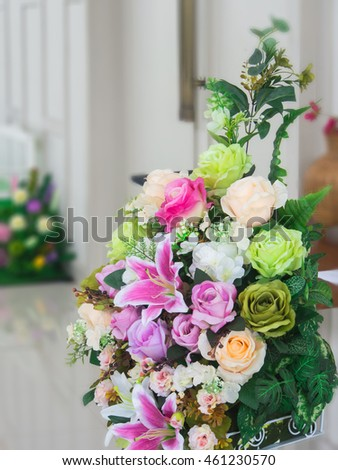 Closeup of colorful decoration artificial flower with blurred background
