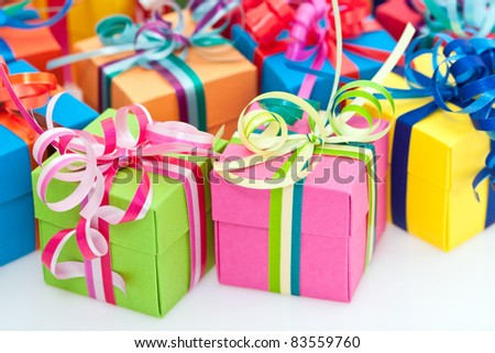Closeup of colorful gifts box on white background - stock photo