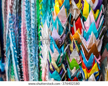 Closeup of colorful origami birds (cranes) in Japan - stock photo