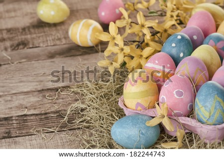 Closeup Of Colorful Vintage Country Style Easter Eggs On Hay Old Barn Wood Boards As