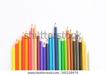 Closeup of Colour pencils on white background, selective focus - stock photo