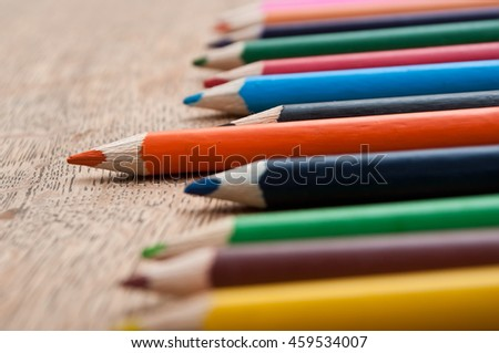 closeup of colouring pencils on wooden background