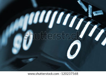 Closeup of combination safe lock with number zero on focus - stock photo