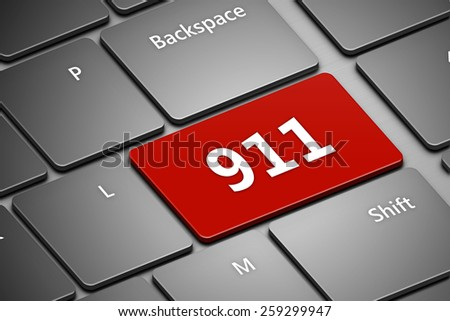 closeup of computer keyboard with emergency number 911