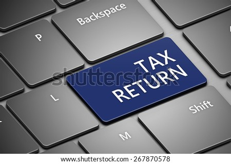 closeup of computer keyboard with tax return button - stock photo