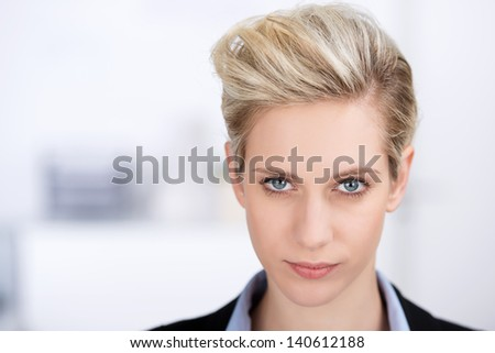 closeup of confident woman looking in camera in office