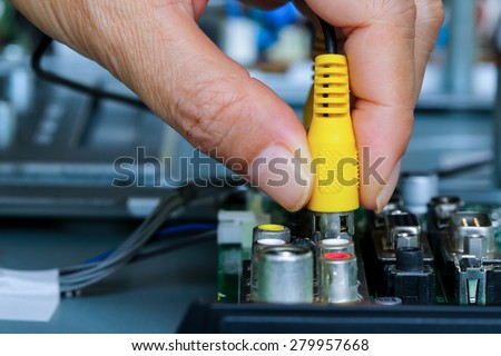 Closeup of Connected video and audio cable. - stock photo