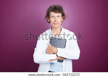 Closeup of Content Senior Woman Holding Book