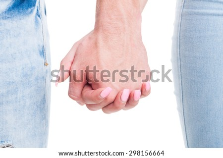 Closeup of couple hands holding together on white background with copy space or text area - stock photo