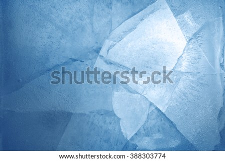 Closeup of cracked blue ice  - stock photo