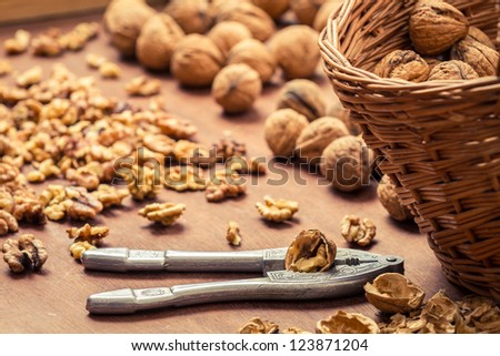 Closeup of cracking walnuts on wicker basket