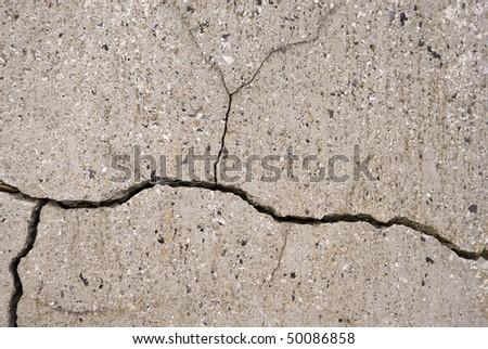 Closeup of cracks in concrete. - stock photo