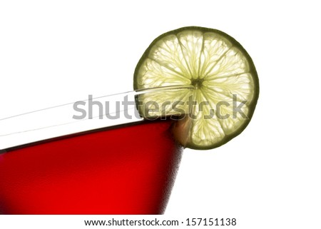 Closeup of Crantini cocktail or cranberry cocktail with slice of lime on white  background - stock photo