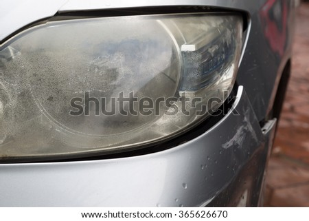 Closeup of crashed car hit on the front bumper off , accident happen on raining day - stock photo
